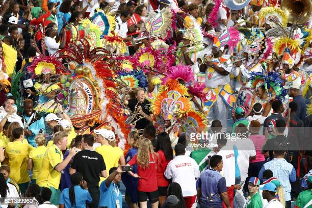 Athletes dance with performers Junkanoo during the Closing Ceremony on day 6 of the 2017 Youth Commonwealth Games at the Thomas A Robinson National...