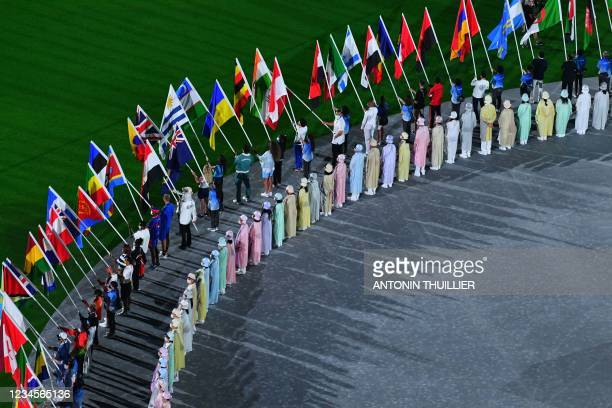 Athletes delegations arrive with their national flag during the closing ceremony of the Tokyo 2020 Olympic Games, at the Olympic Stadium, in Tokyo,...