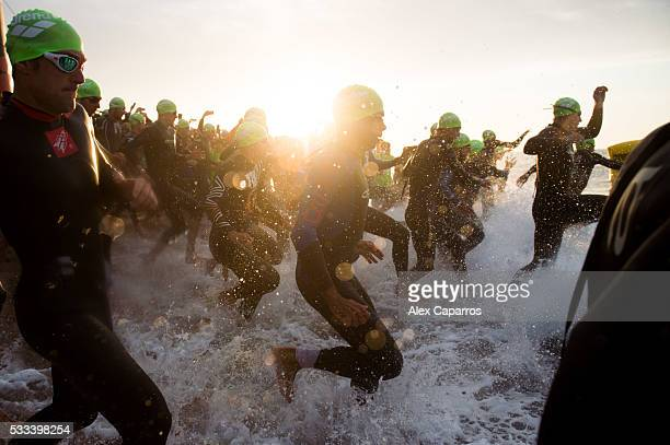 Athletes dive into the sea as they start the swim leg of Ironman 703 Barcelona race on May 22 2016 in Barcelona Spain