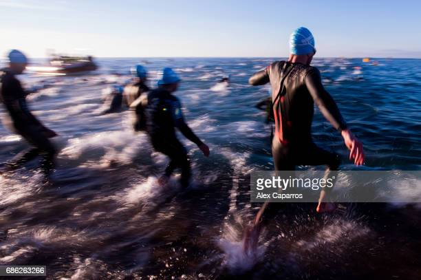 Athletes dive into the sea for the swim leg of Ironman 703 Barcelona race on May 21 2017 in Barcelona Spain