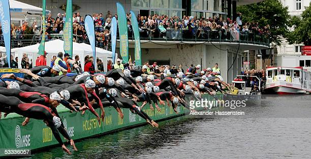 Athletes dive into the water at the Binnenalster at the start of the Holsten City Man Elite Triathlon on August 7 2005 in Hamburg Germany