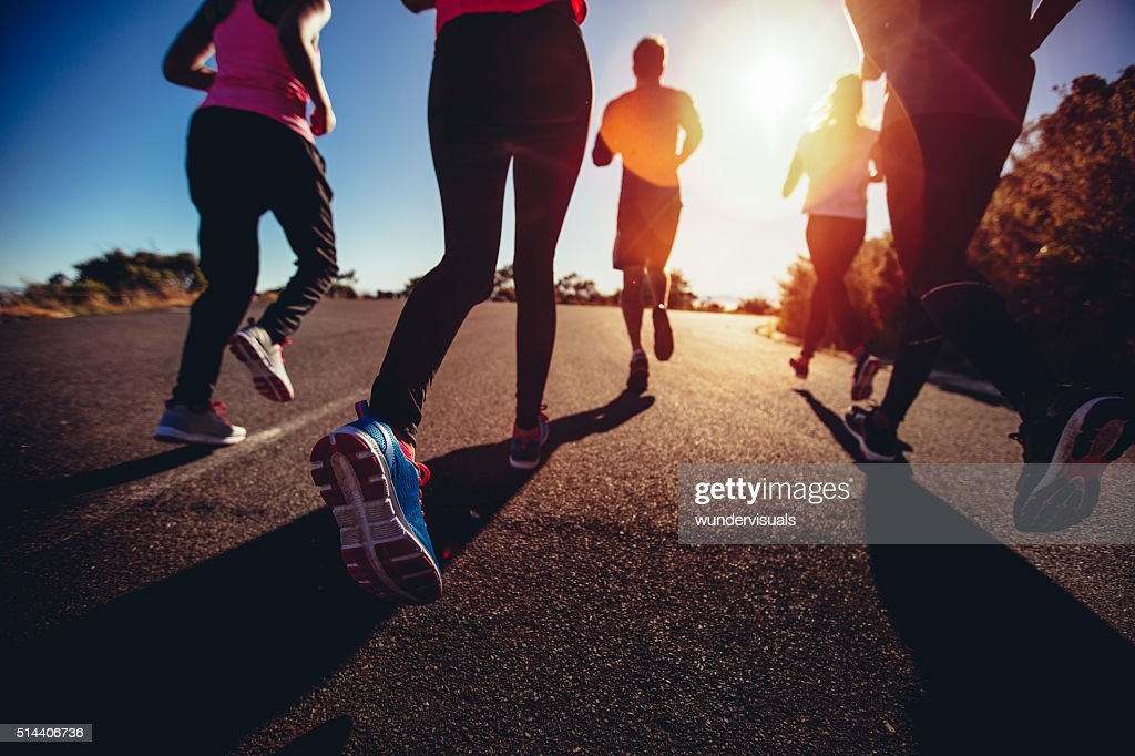 Athletes doing a jogging workout outdoors : Stock Photo