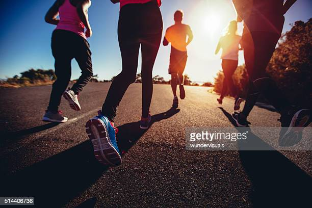 athletes doing a jogging workout outdoors - running stock pictures, royalty-free photos & images