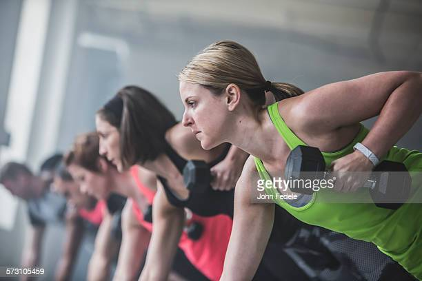 Athletes doing push-ups and lifting weights