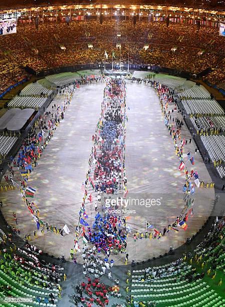 Athletes enter Maracana Stadium during the closing ceremony of the Rio de Janeiro Olympics on Aug 21 2016