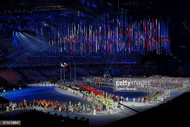 Athletes enter the 2014 Sochi Winter Olympics Closing Ceremony at Fisht Olympic Stadium on February 23 2014 in Sochi Russia