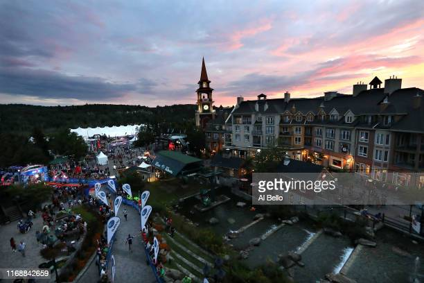 Athletes enter the finish area during the Subaru IRONMAN MontTremblant presented by Sportium on August 18 2019 in Mont Tremblant Canada