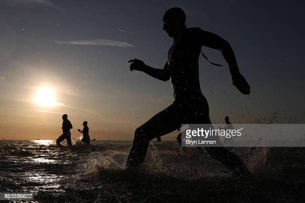 Athletes enter the sea at the start of the swim leg of IRONMAN Italy Emilia Romagna on September 23 2017 in Cervia Italy