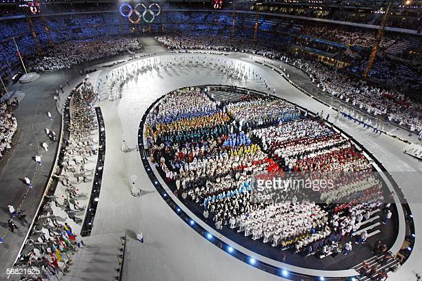 Athletes enter the stadium during the Opening Ceremony of the Turin 2006 Winter Olympic Games on February 10 2006 at the Olympic Stadium in Turin...
