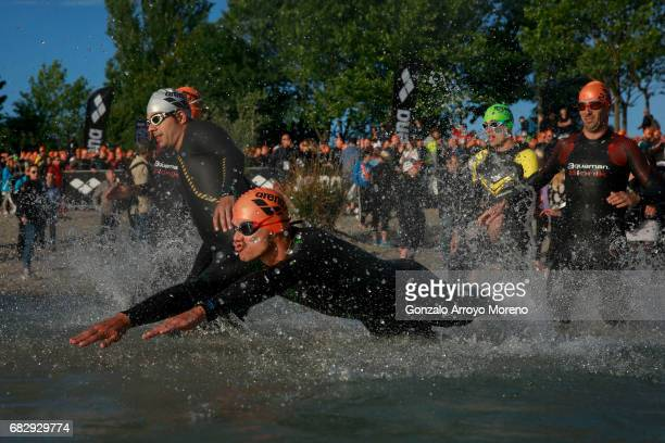 Athletes enter the water during the rolling start of the Ironman 703 Pays d'Aix swimming course on May 14 2017 at Lake Peyrolles France