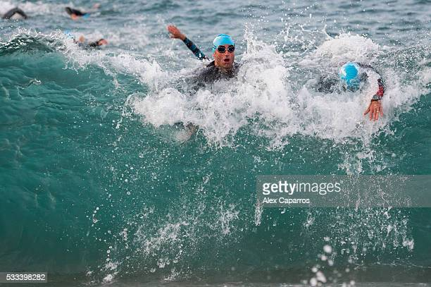 Athletes exit the water after completing the swim leg of Ironman 703 Barcelona race on May 22 2016 in Barcelona Spain