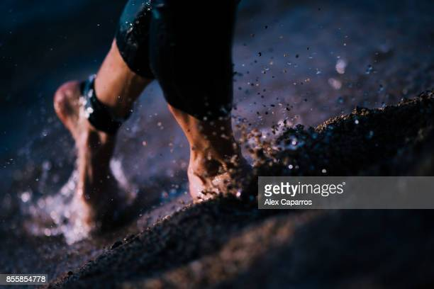 Athletes exit the water after finishing the swimming course of the IRONMAN Barcelona on September 30 2017 in Calella Barcelona province Spain
