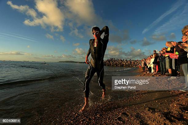 Athletes exit the water on the swim course during Ironman Weymouth on September 11 2016 in Weymouth England