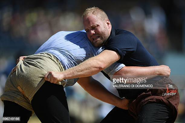 Athletes fight during the first day of the Federal Alpine Wrestling Festival on August 27 in Payerne western of Switzerland More than 200000...