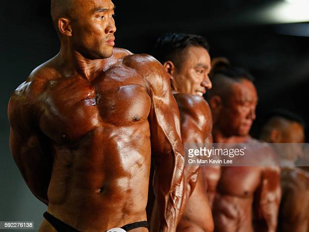 Athletes flex their muscles during the Arnold Classic Asia MultiSport Festival on August 20 2016 in Hong Kong Hong Kong
