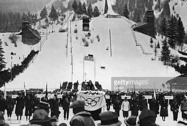 Athletes from 28 nations listen to the speech of Karl Ritter von Halt president of the GarmischPartenkirchen Olympic organizing committee 06 February...