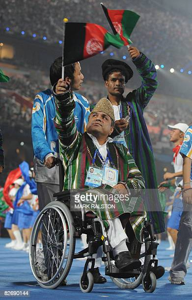 Athletes from Afghanistan parade at the National Stadium during the opening ceremony for the 2008 Beijing Paralympic Games in the Chinese capital on...