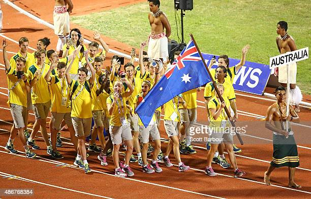 Athletes from Australia enter the arena during the Opening Ceremony of the Vth Commonwealth Youth Games at Apia Park on September 5 2015 in Apia Samoa