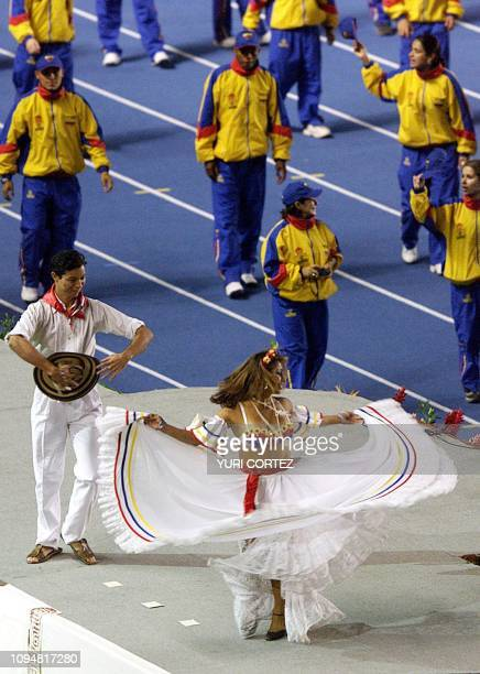 Athletes from Colombiac wave to the crowd during the opening ceremony of the XIX Central American and Caribbean Games Fireworks at the Flor Blanca...