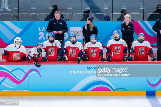 Athletes from Czech Republic look on from bench during Women's 6-Team Tournament Preliminary Round - Group B Game between Czech Republic and...