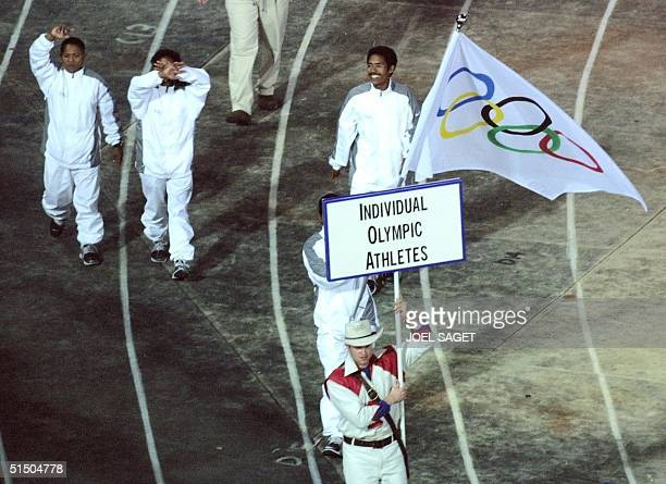 Athletes from East Timor invited as Individual Olympic Athletes by the International Olympic Committee march during the 'Parade of Nations' at the...