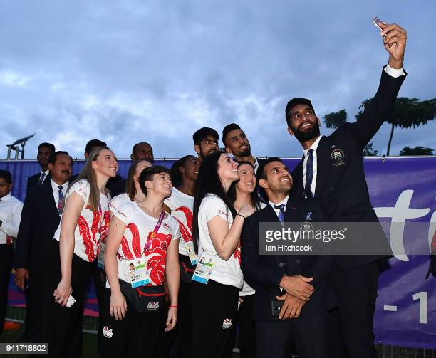 Athletes from England and India pose for a selfie at Jezzine Barracks during an official welcome ceremony ahead of the 2018 Commonwealth Games on...