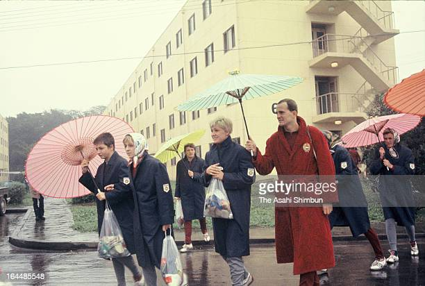 Athletes from Hungary walk with Japanese umbrellas for training session in the Athletes Village ahead of Tokyo Olympic on October 1 1964 in Tokyo...