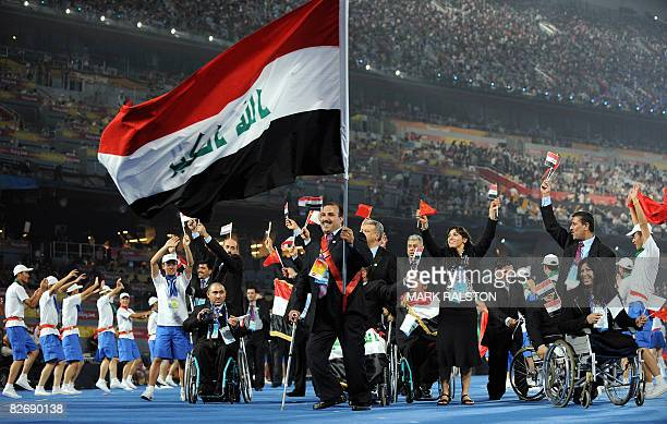 Athletes from Iraq parade at the National Stadium during the opening ceremony for the 2008 Beijing Paralympic Games in the Chinese capital on...