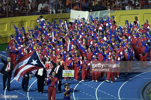 Athletes from Puerto Rico wave to the crowd during the opening ceremony of the XIX Central American and Caribbean Games Fireworks at the Flor Blanca...