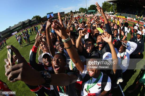 Athletes from Team USA pose together for a selfie on the infield following the completio of day six of the IAAF World Junior Championships at Hayward...