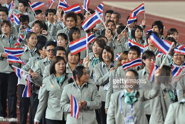 Athletes from Thailand parade waving their national flag during the opening ceremony of the 25th Southeast Asian Games at the national stadium in...