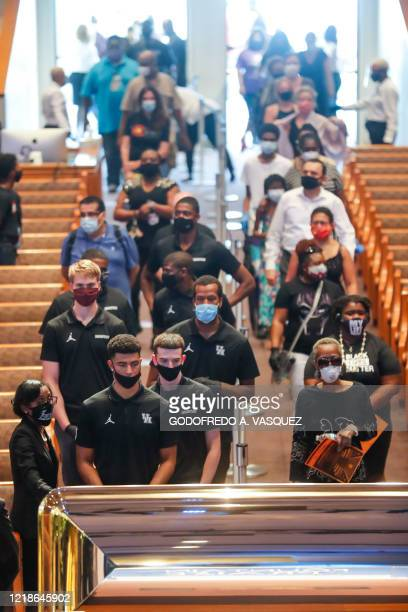 Athletes from the University of Houston view the casket of George Floyd during a public visitation Monday, June 8 at The Fountain of Praise church in...