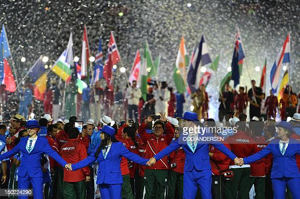 Athletes from various nations parade before the Olympic Flame during the closing ceremony of the 2012 London Olympic Games at Olympic Stadium on...