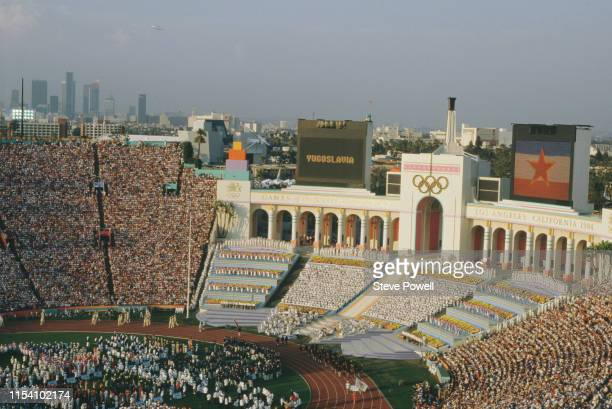 Athletes from Yugoslavia parade on the stadium infield defying the boycott by Eastern Bloc nations during the opening ceremony for the XXIII Olympic...