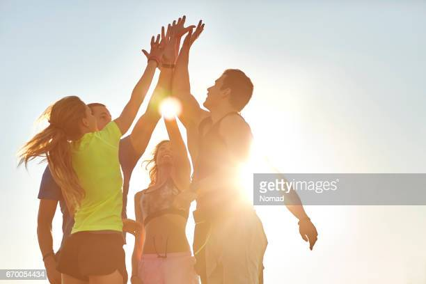 athletes high fiving after successful workout - active lifestyle stock pictures, royalty-free photos & images