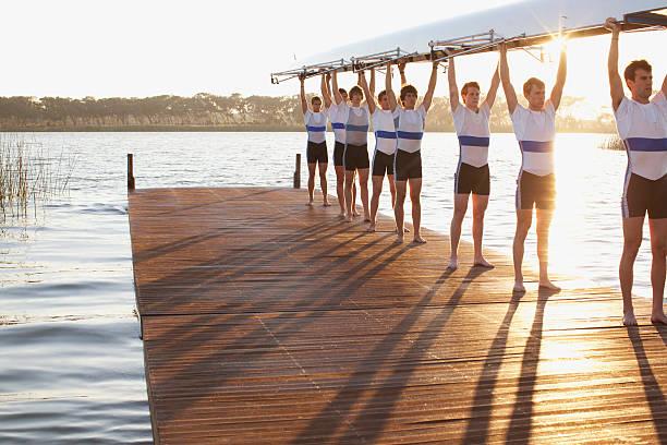 Athletes holding their boat upwards