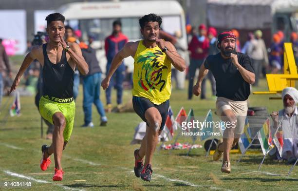 Athletes in action during the 100meter race on the 2nd day of the 82nd Kila Raipur Rural Olympics 2018 in the village Kila Raipur on February 3 in...
