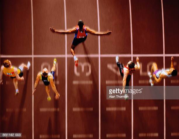 athletes in race crossing finishing line, overhead view (composite) - track and field stadium stock pictures, royalty-free photos & images