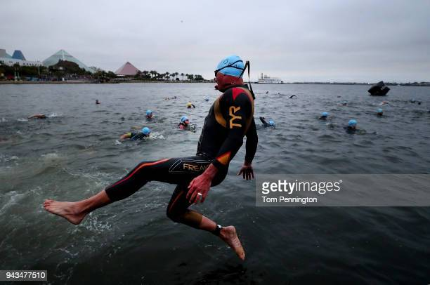 Athletes in the Age Group divisions prepare to compete in the swim portion of the Memorial Hermann IRONMAN 703 Texas on April 8 2018 in Galveston...