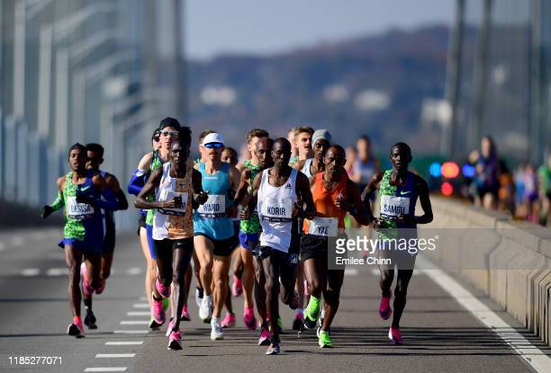 Athletes in the Men's Professional Division compete at the start of the TCS New York City Marathon on November 03, 2019 in the Staten Island borough...