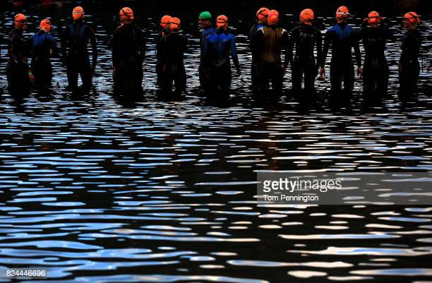 Athletes in the Pro Women's Division wait for the start of the Subaru Ironman Canada triathlon on July 30 2017 in Whistler Canada