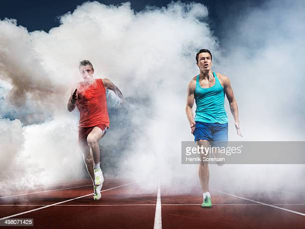 2 athletes in white smoke