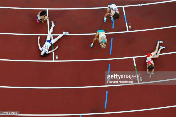 Athletes including Laura Muir of Great Britain react following the womens 5000 metres heats during day seven of the 16th IAAF World Athletics...