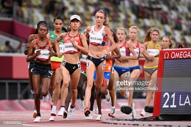 Athletes, including Uganda's Mercyline Chelangat, Japan's Ririka Hironaka and Britain's Eilish McColgan, compete in the women's 10,000m final during...