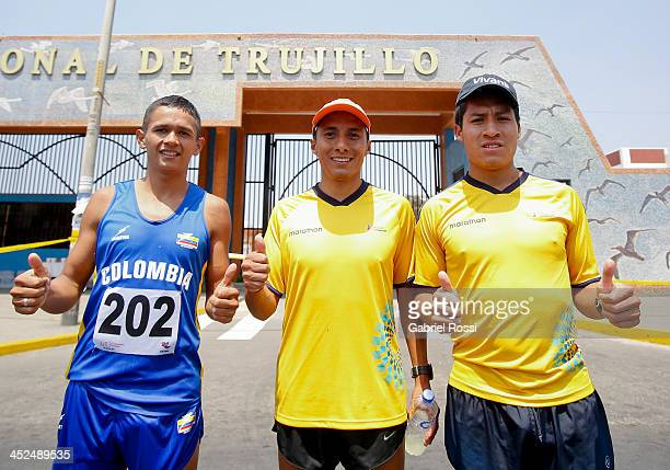 Athletes Jorge Ruiz of Colombia Cristian Chocho of Ecuador and Jonnathan Caceres of Ecuador pose for a picture after competing in 50k walk race as...