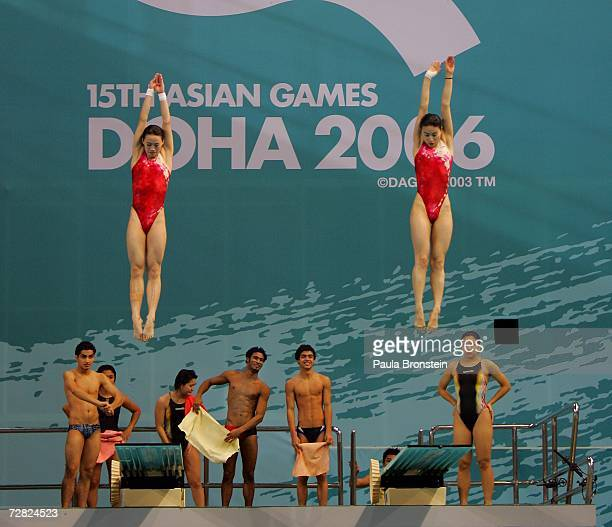 Athletes jump off the 3 meter springboard during diving pratice at the 15th Asian Games in Doha Qatar December 11 2006 The games feature 45 countries...