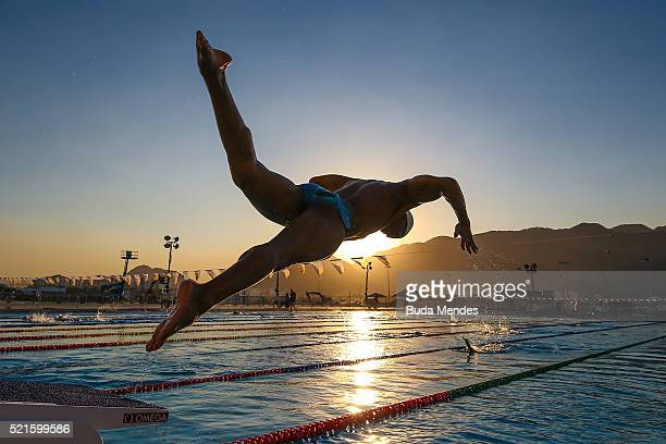 Athletes jumps into the pool during the warm up at the Aquece Rio Test Event for the Rio 2016 Olympics at the Olympic Aquatics Stadium in the Olympic...