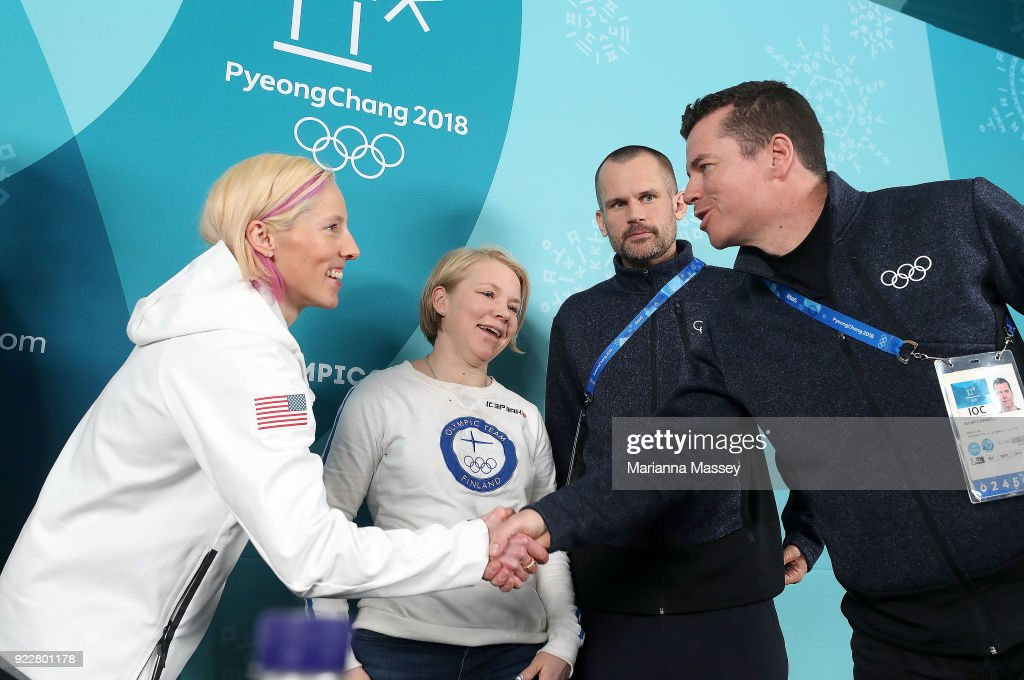 Athletes Kikkan Randall of the United States and Emma Terho of Finland shake hands with Director of the IOC Kit McConnell after being announced as new members of the Athletes' Commission during a press conference revealing the results on day thirteen of the PyeongChang 2018 Winter Olympic Games at the Athletes' Village on February 22, 2018 in Pyeongchang-gun, South Korea.
