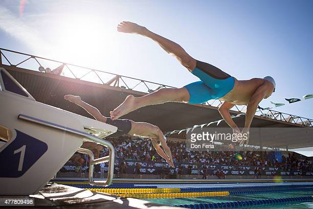 Athletes leave the diving board on day two of the 2015 Arena Pro Swim Series at the George F Haines International Swim Center on June 19 2015 in...