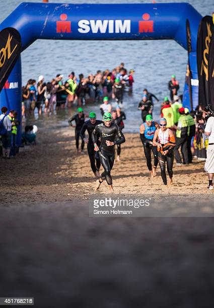 Athletes leave the water after the swimming of the Ironman Frankfurt on July 6 2014 in Frankfurt am Main Germany